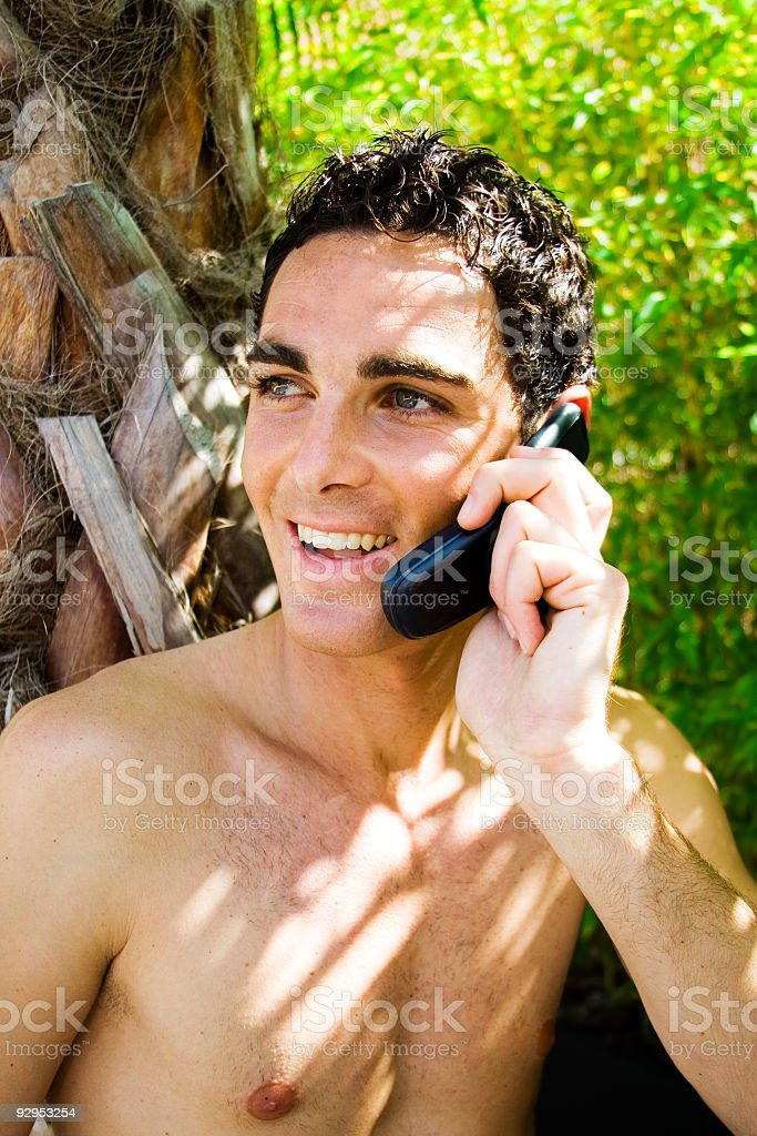 Relaxed young man with mobile phone royalty-free stock photo