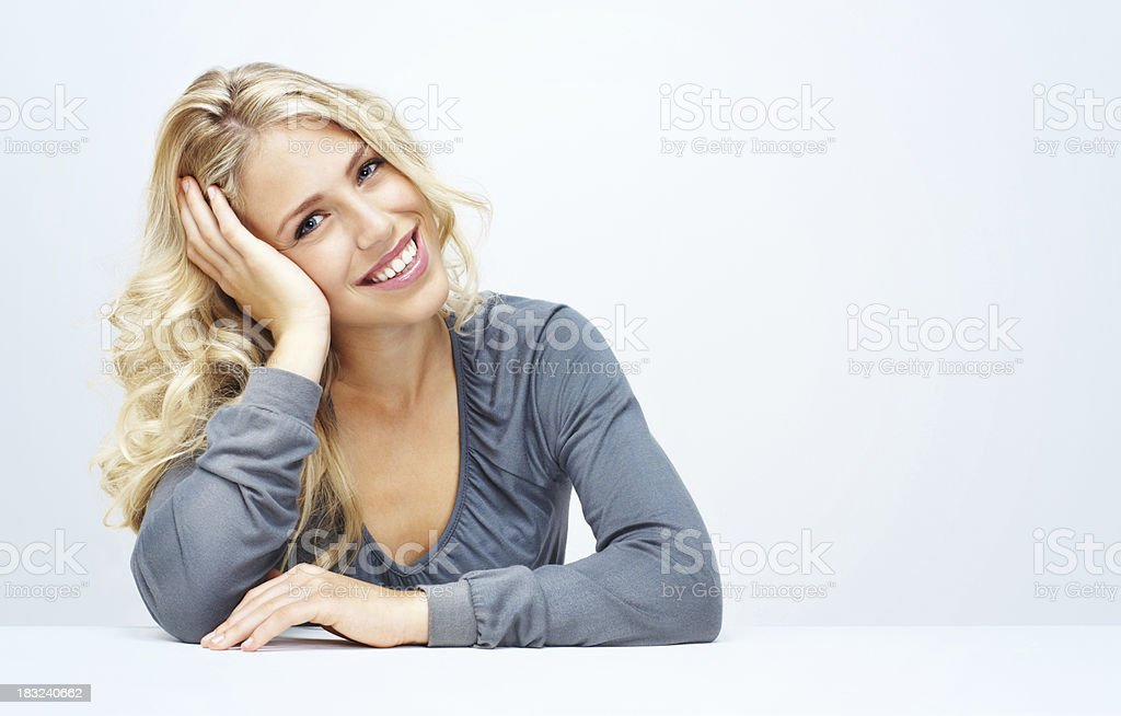 Relaxed young woman against white background - copyspace royalty-free stock photo