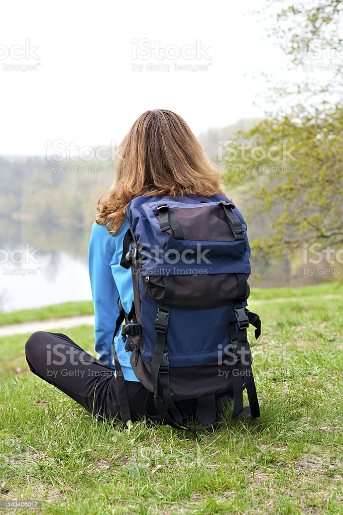 Relaxes Tourist Sitting on the Grass royalty-free stock photo