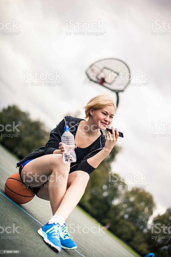 Relaxing after basketball match at playground stock photo