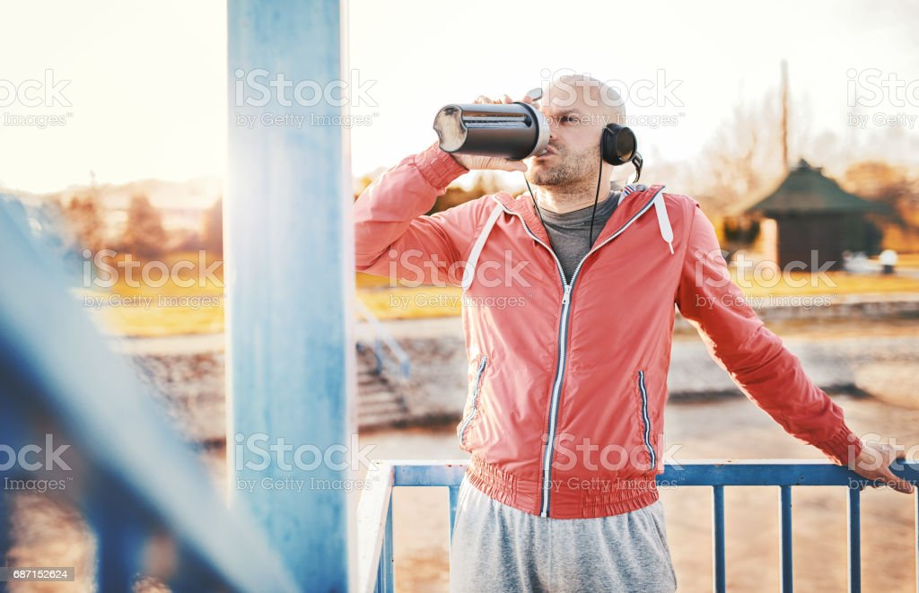 Relaxing after fitness training outdoors. Sport, fitness, workout stock photo
