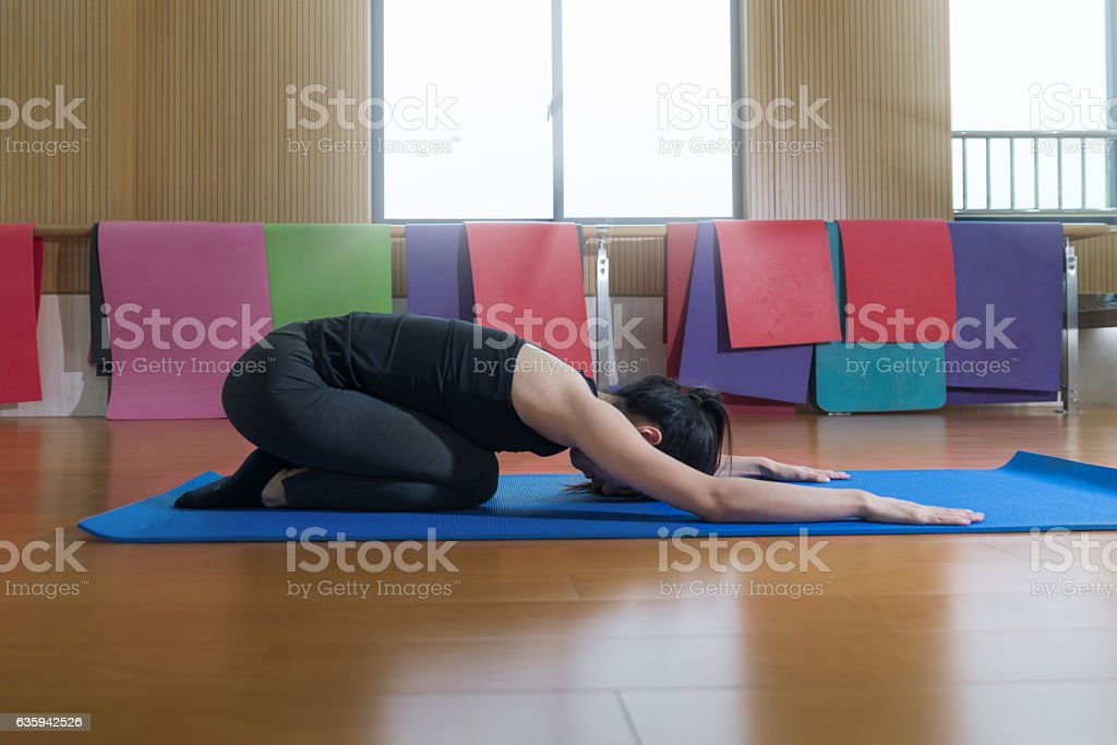 Relaxing and Doing Yoga stock photo