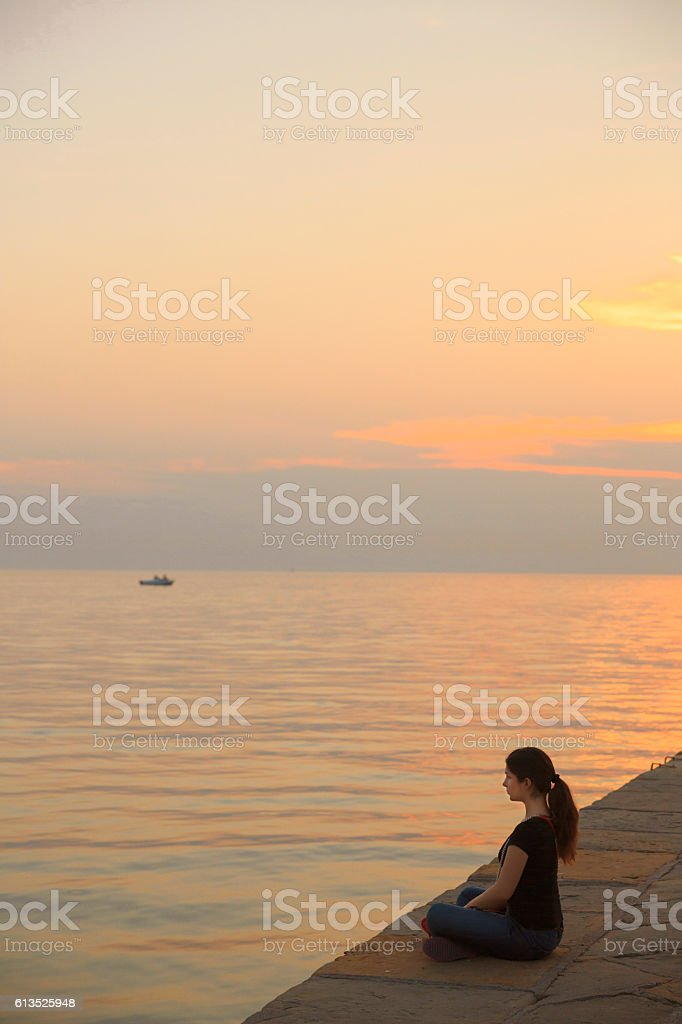 Relaxing and enjoy  Sunset at sea  Young women casual lifestyles stock photo