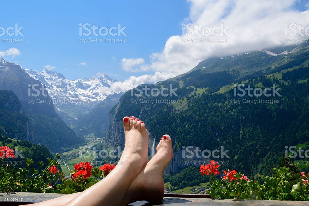 Relaxing and enjoying  the view of the mountains stock photo
