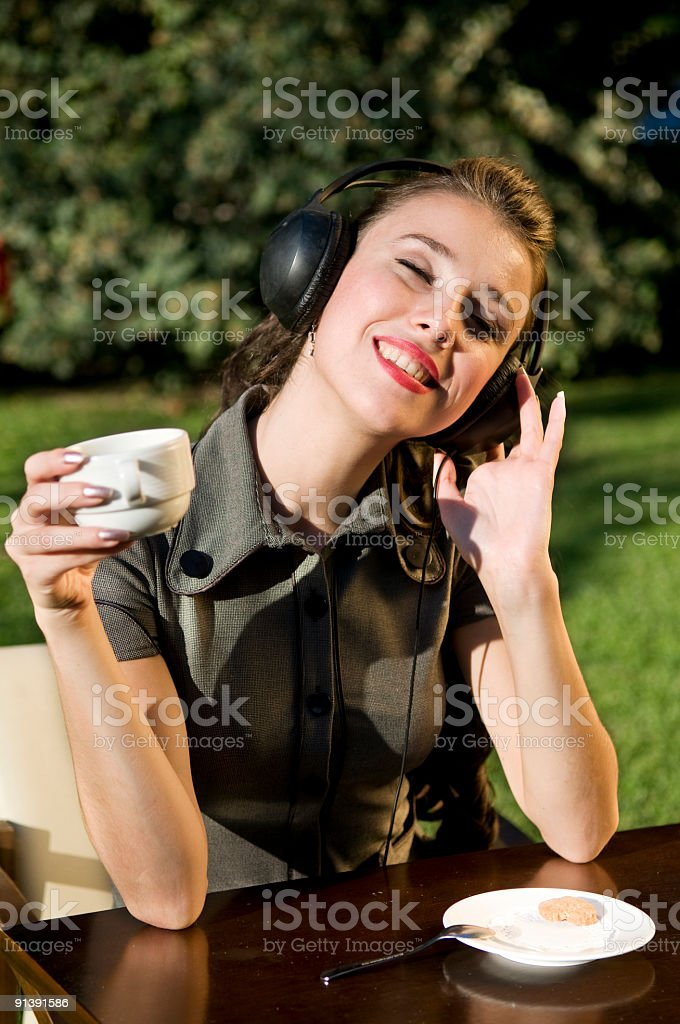 relaxing and listening to music with coffee royalty-free stock photo