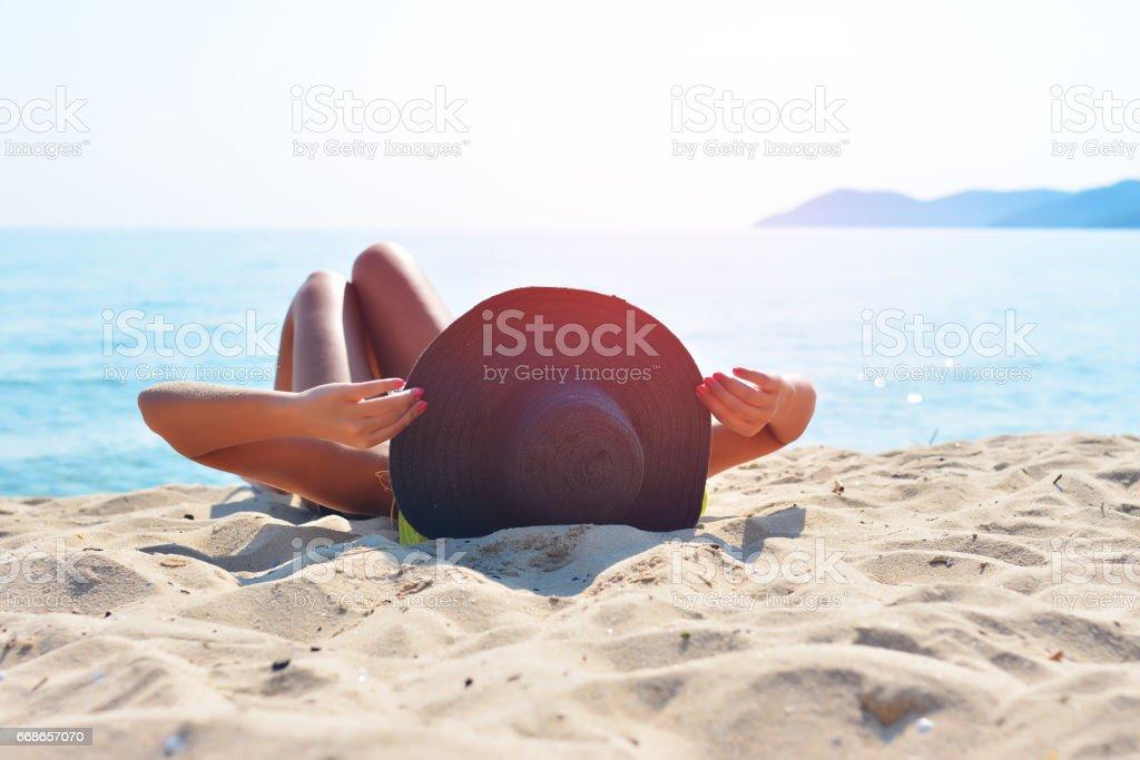 Pretty woman sunbathing on the beach