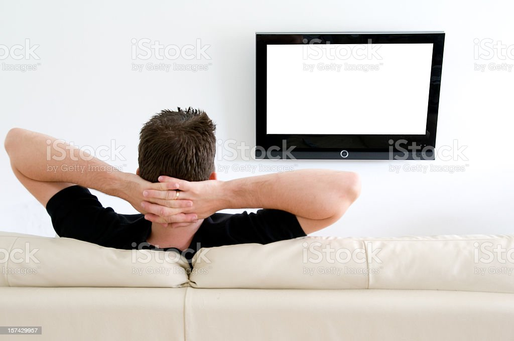 Relaxing and watching tv on a sofa at home royalty-free stock photo