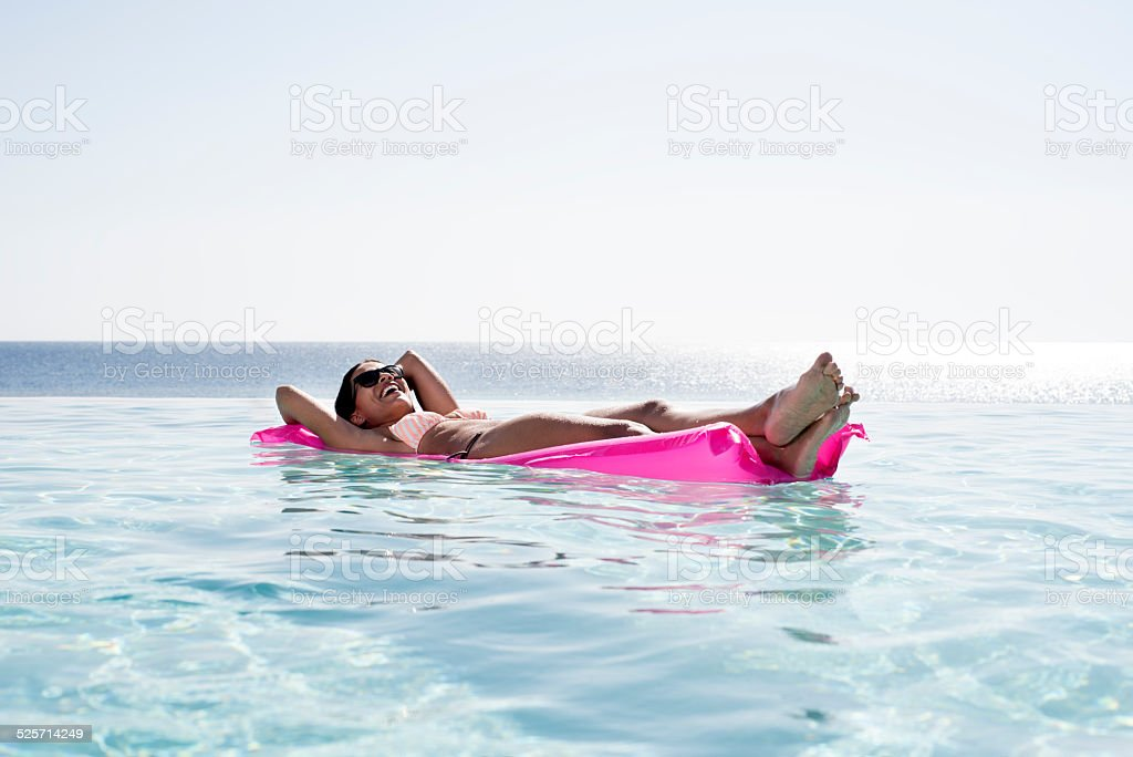 Relaxing at infinity pool. stock photo