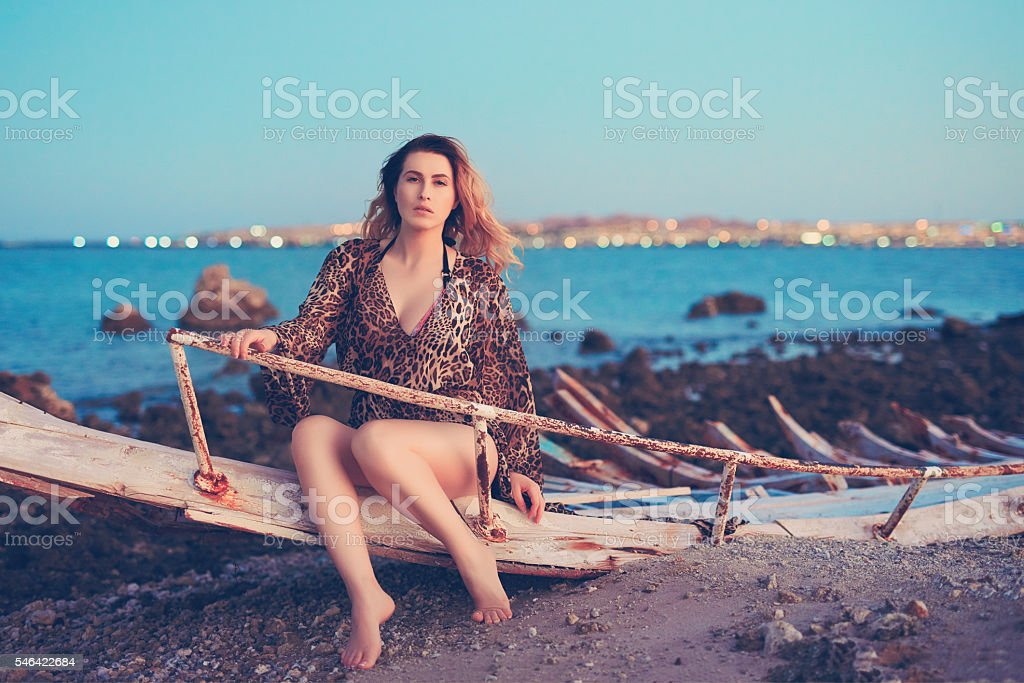 relaxing at the edge of the sea stock photo