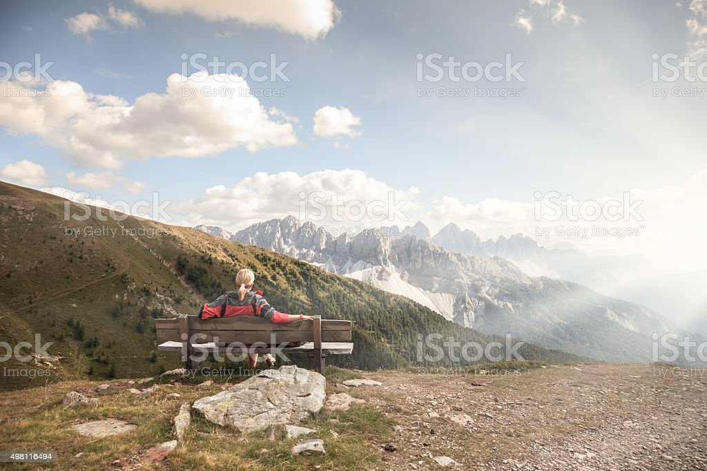 Relaxing before stunning mountains scenery stock photo