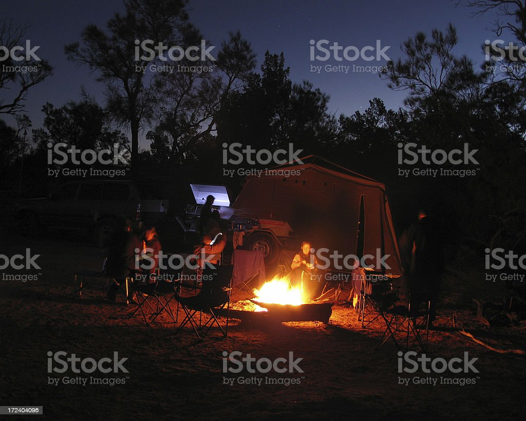 Relaxing by Camp Fire stock photo
