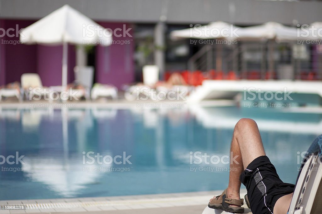 relaxing by the pool royalty-free stock photo