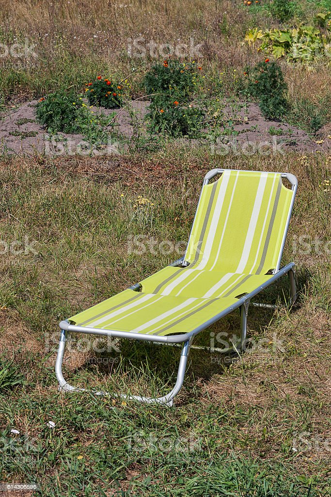 relaxing chair ready to use on grass stock photo