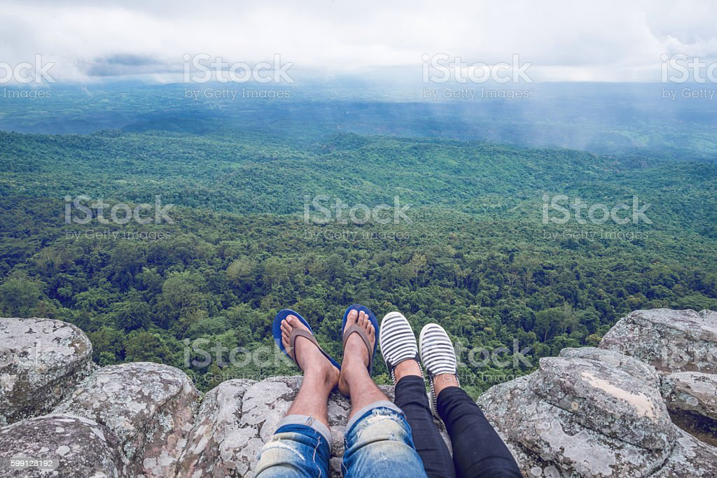 Relaxing cliffside stretch legs Below the forest stock photo