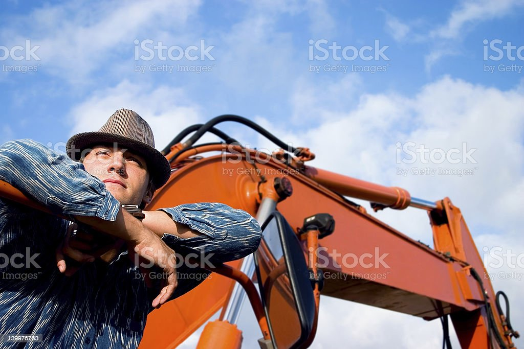 Relaxing Construction Worker & Crane royalty-free stock photo