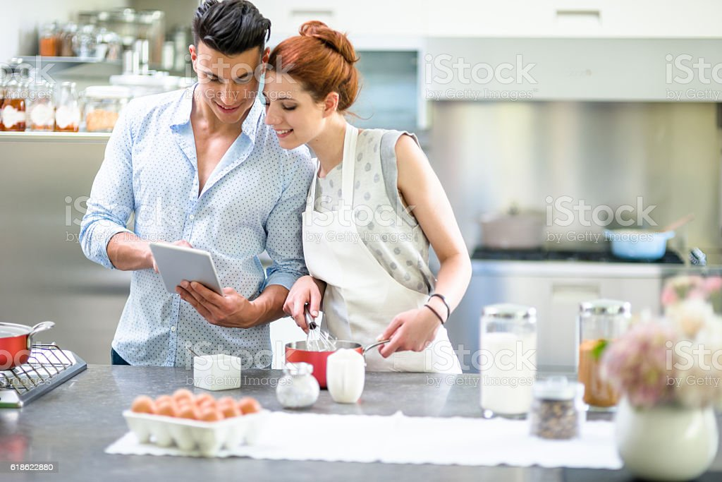 Relaxing couple on the kitchen cooking stock photo