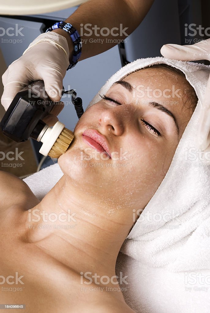 Relaxing face treatment in spa stock photo
