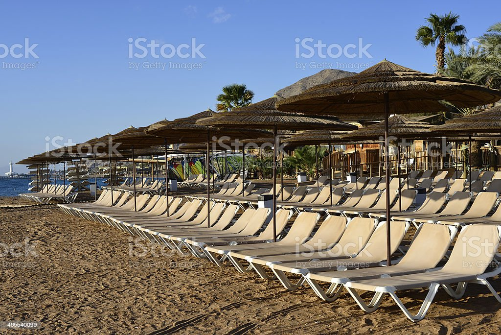 Relaxing facilities at sandy beach of the Red Sea, Eilat royalty-free stock photo
