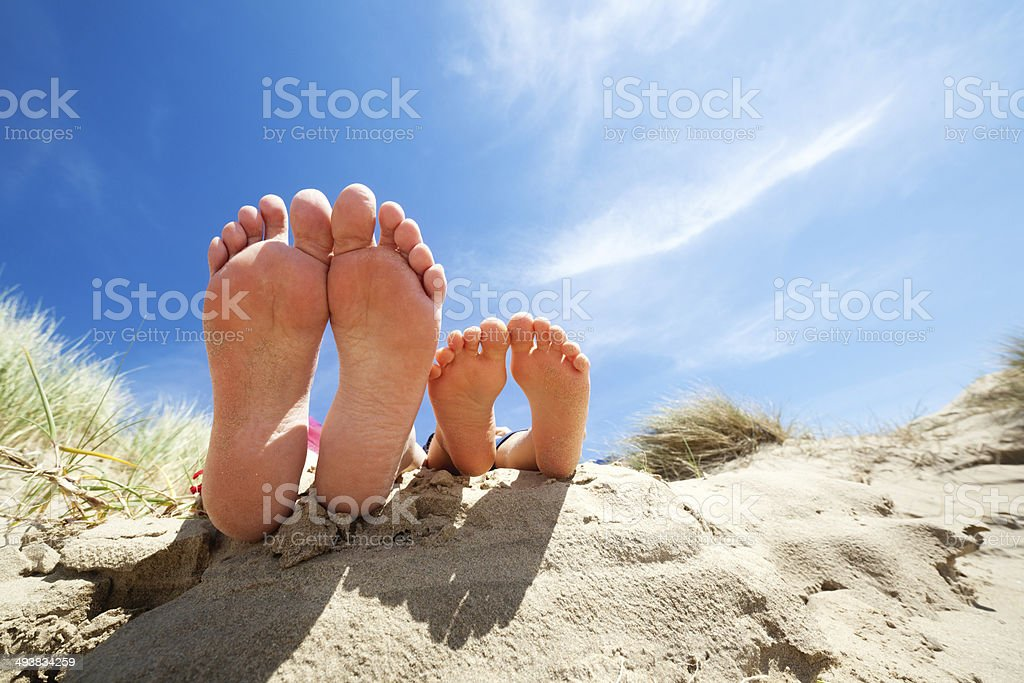 Relaxing feet on the beach stock photo