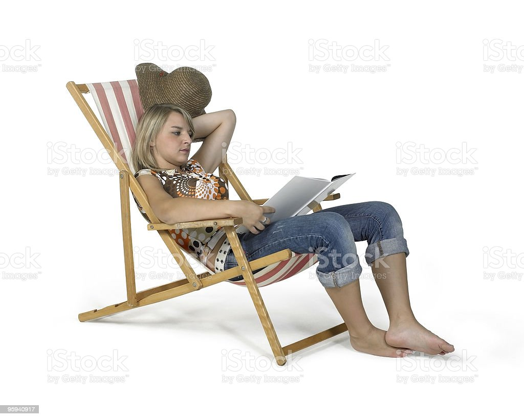 relaxing girl in canvas chair royalty-free stock photo