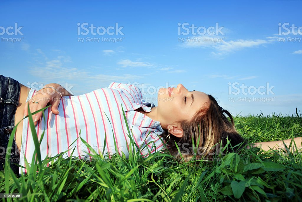 Relaxing girl on meadow royalty-free stock photo
