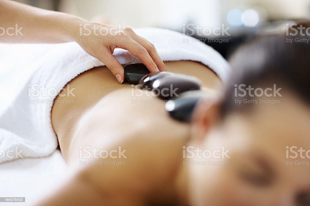 Relaxing Hot Stone Massage Treatment stock photo