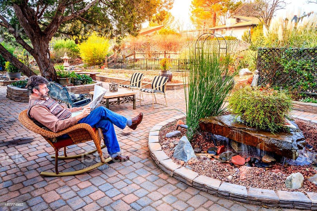 Relaxing in a garden stock photo