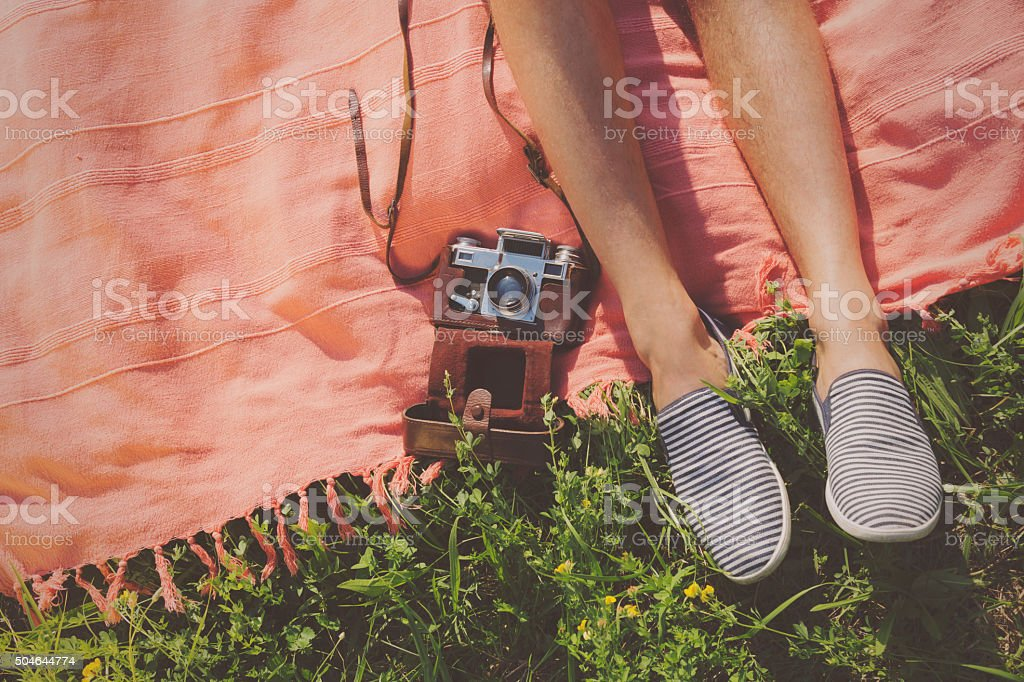 Relaxing in a meadow in the summer sun. stock photo