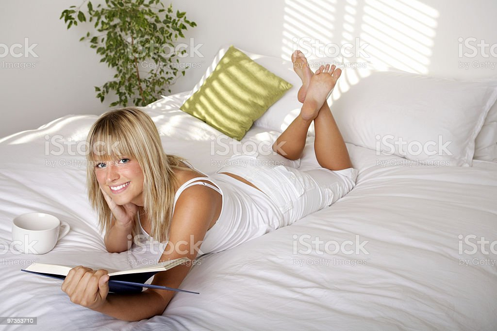 Relaxing in bed royalty-free stock photo