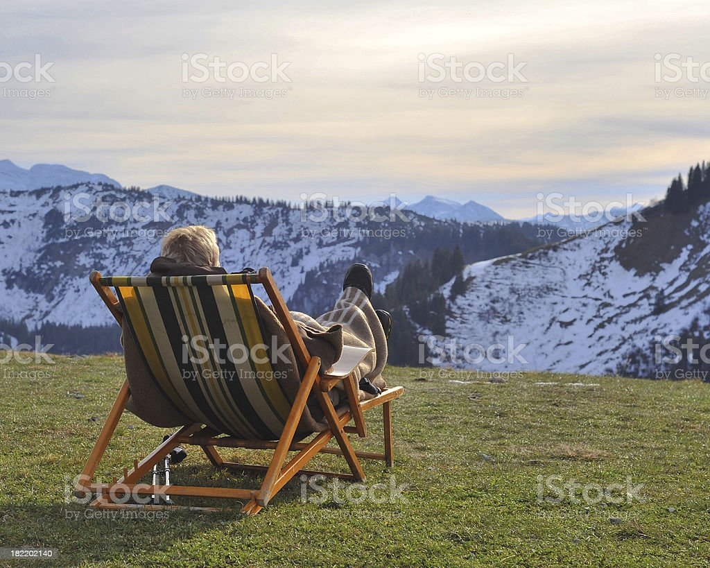 relaxing in chair on mountain peak royalty-free stock photo
