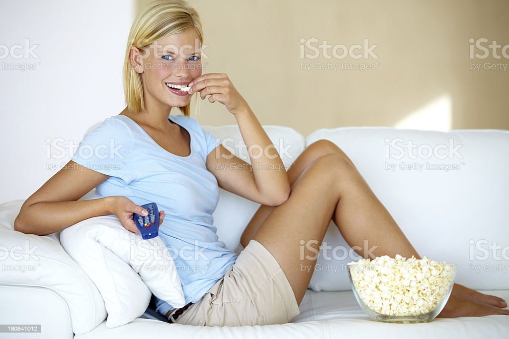 Relaxing in front of the tv royalty-free stock photo