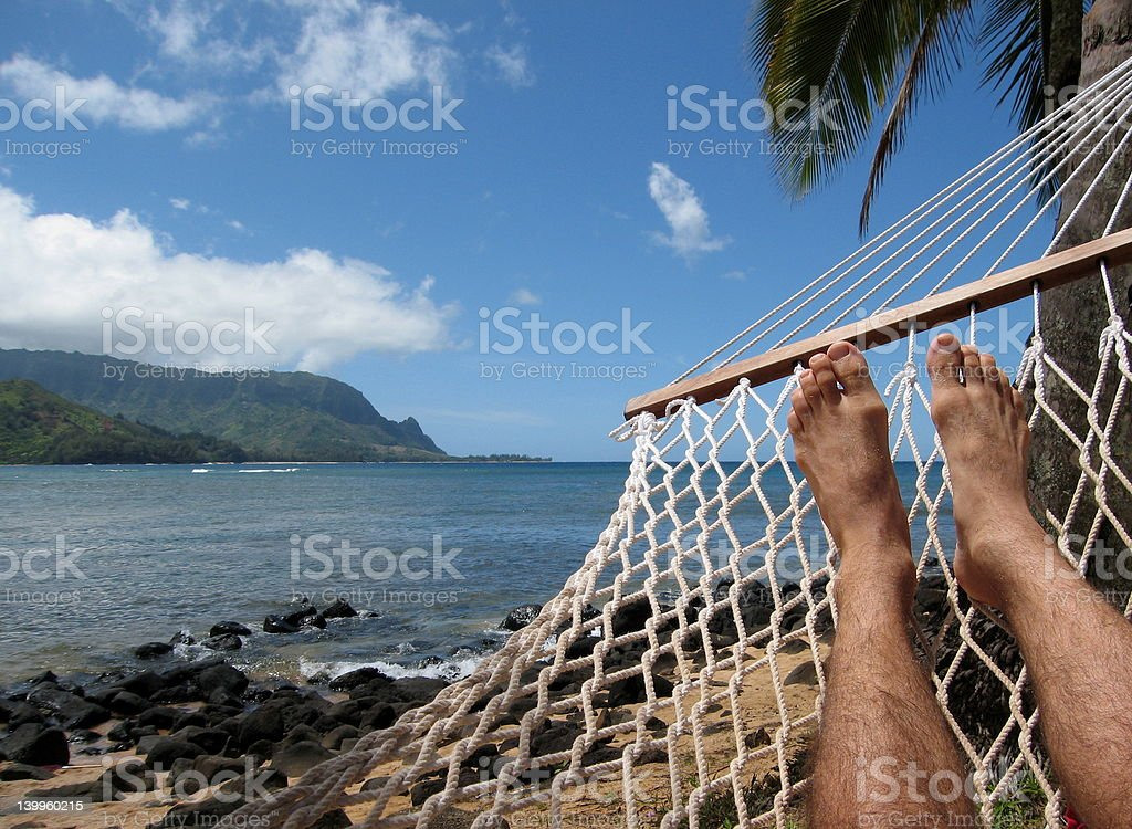 Relaxing in Hawaii hammock royalty-free stock photo