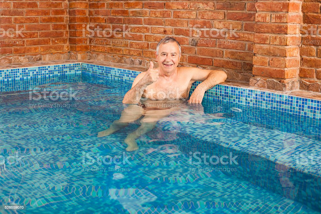 Relaxing in hydromassage pool stock photo