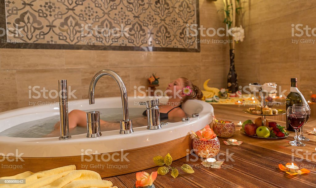 relaxing in jacuzzi stock photo