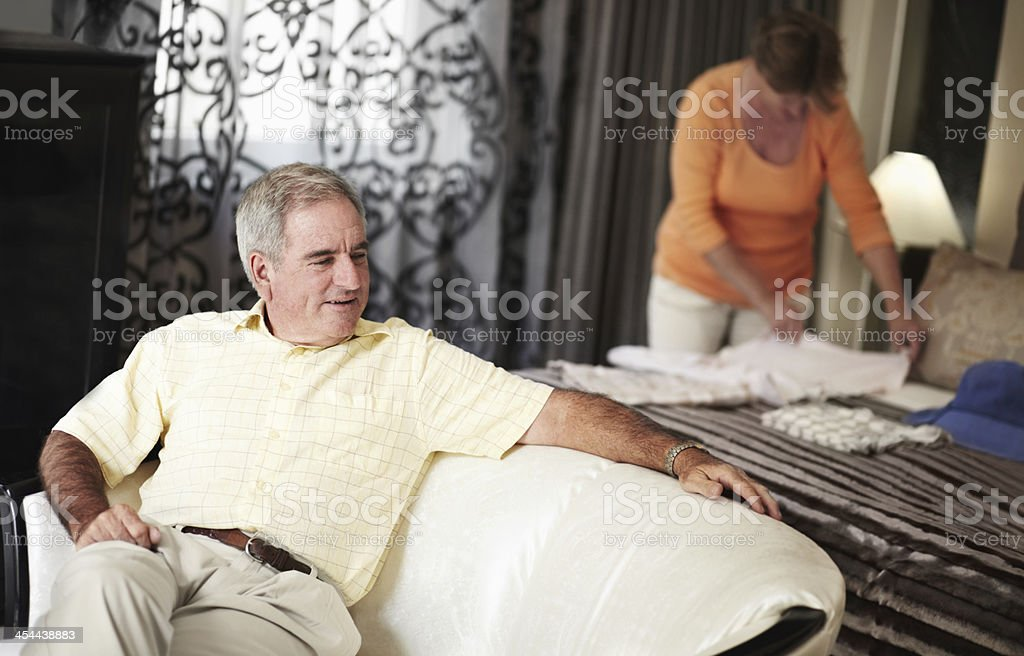 Relaxing in their plush hotel room royalty-free stock photo