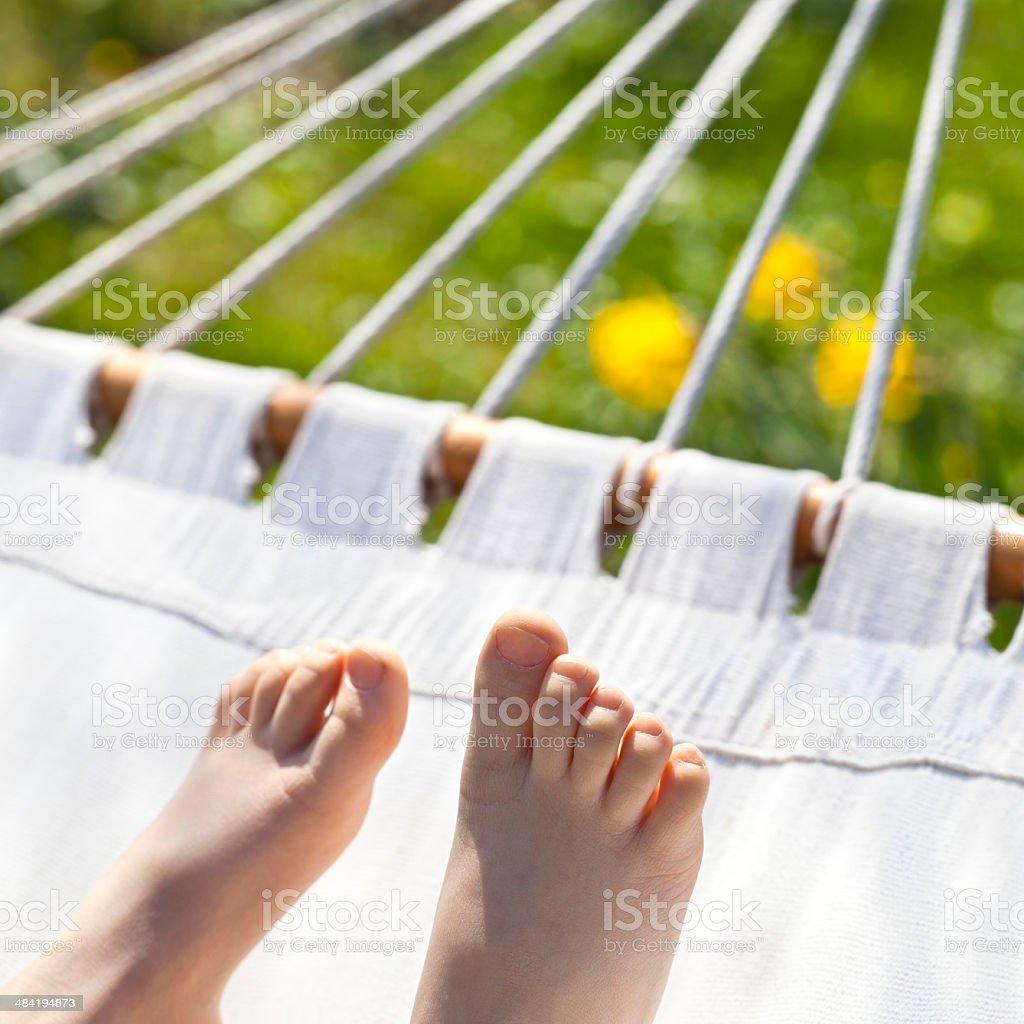 Relaxing Kid on hammock stock photo