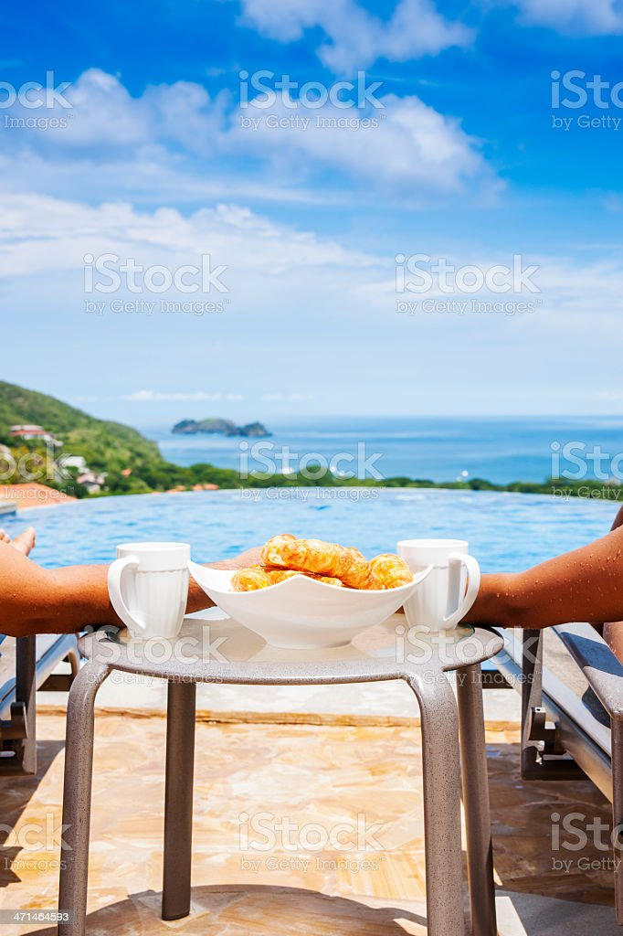 Relaxing looking by the pool royalty-free stock photo