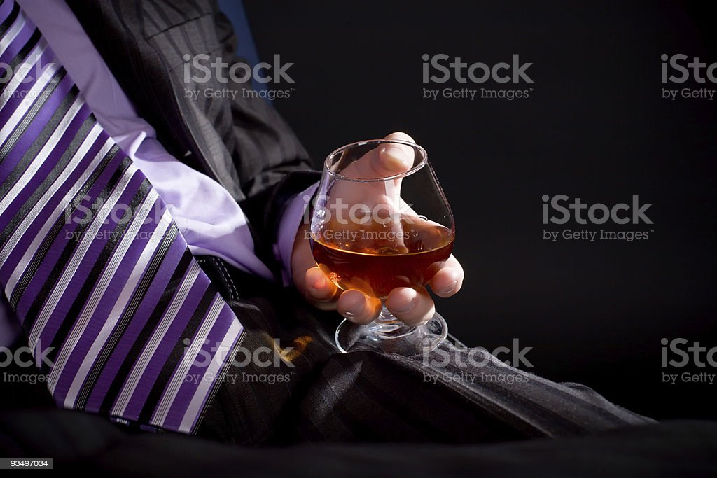 Relaxing man with cognac stock photo