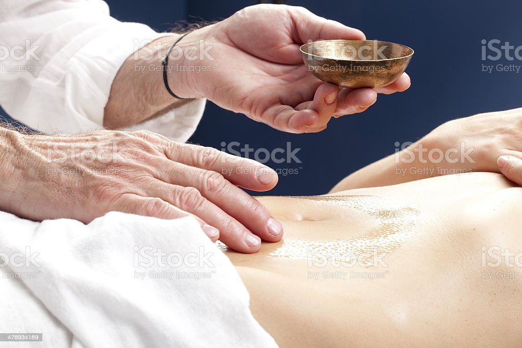 relaxing massage for stimulating pancreas and stomach royalty-free stock photo