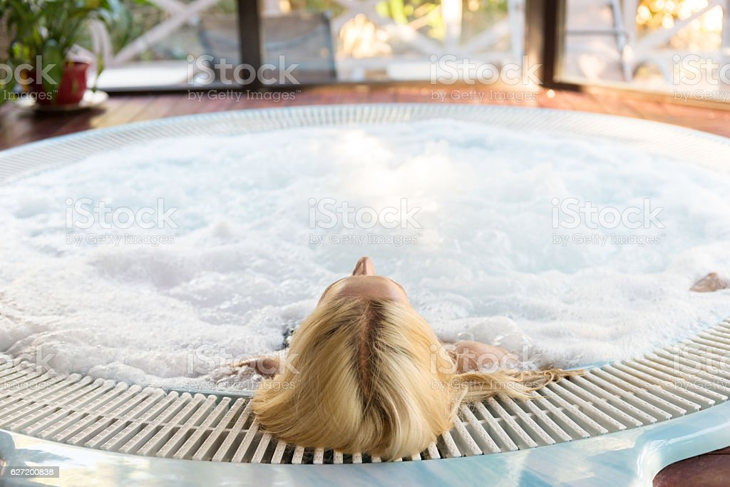 Relaxing massage in hot tube stock photo