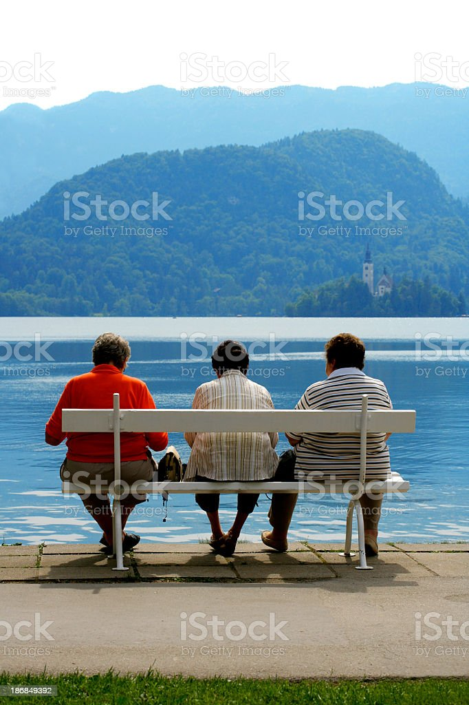 Relaxing on a bench stock photo