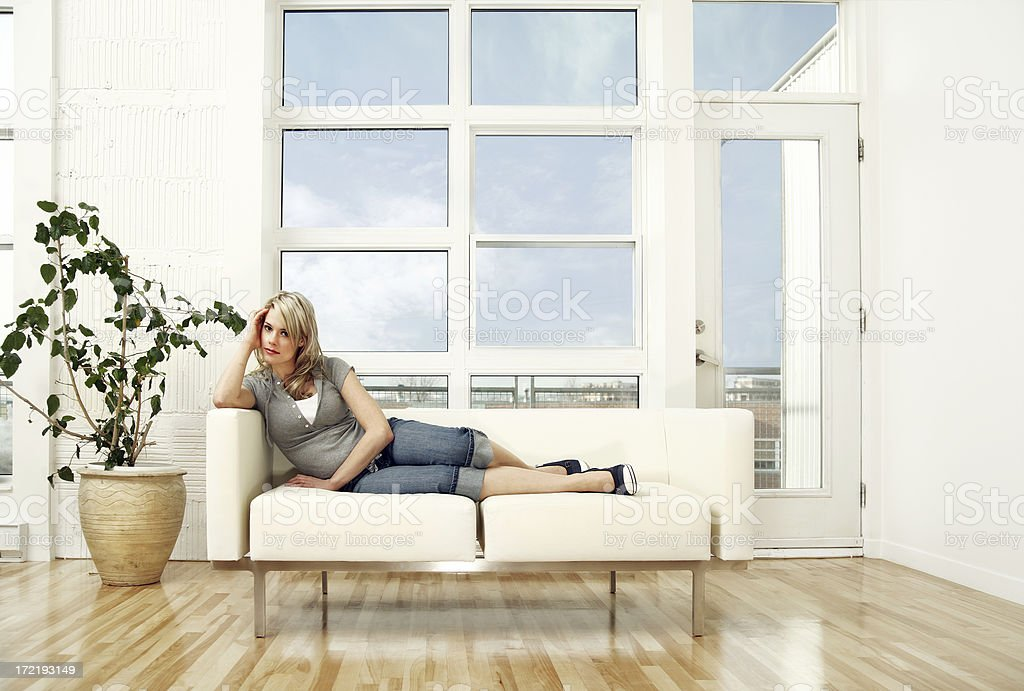 Relaxing on a couch royalty-free stock photo