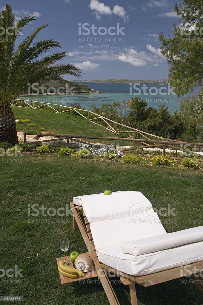 relaxing on a deck chair with breakfast served royalty-free stock photo