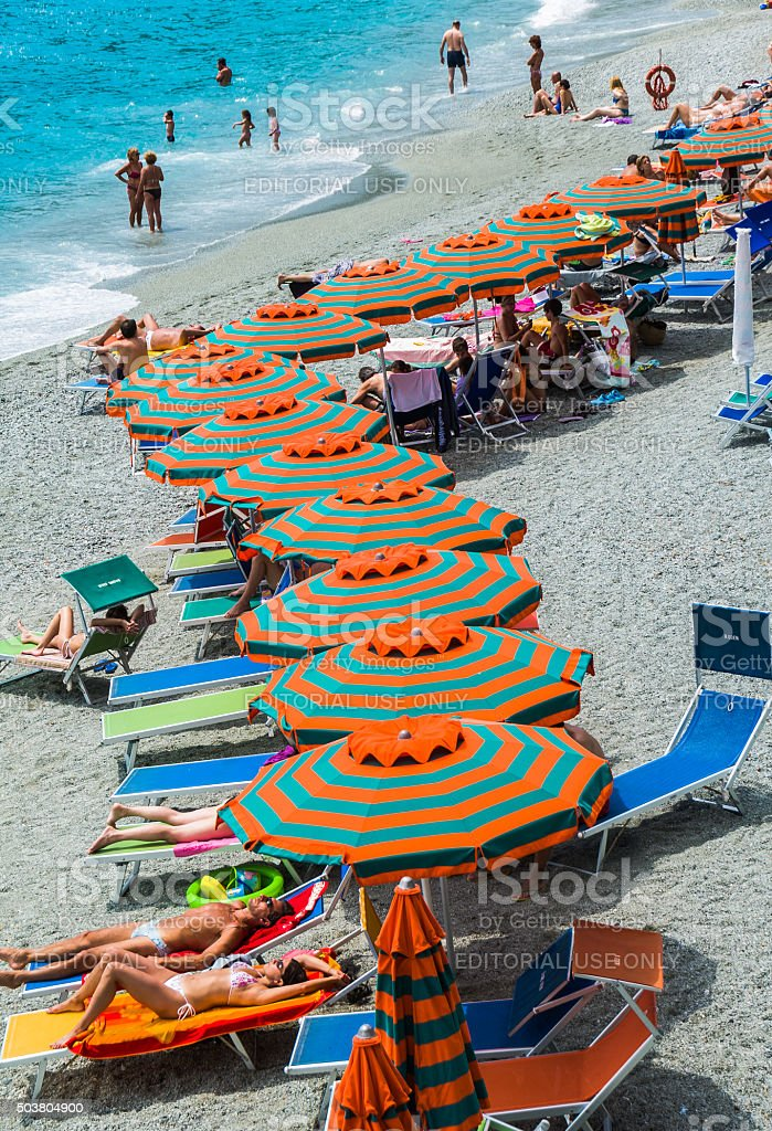 Relaxing on a Monterosso Beach stock photo