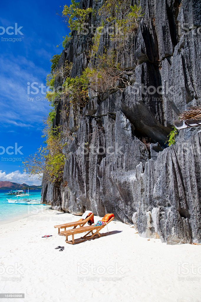 Relaxing on Banol beach in Coron, Philippines stock photo