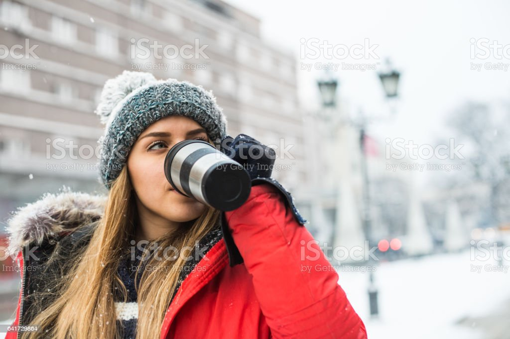 Relaxing on city streets, drinking hot coffee stock photo