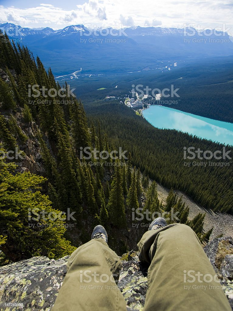 Relaxing on Cliffs in Large Mountains stock photo