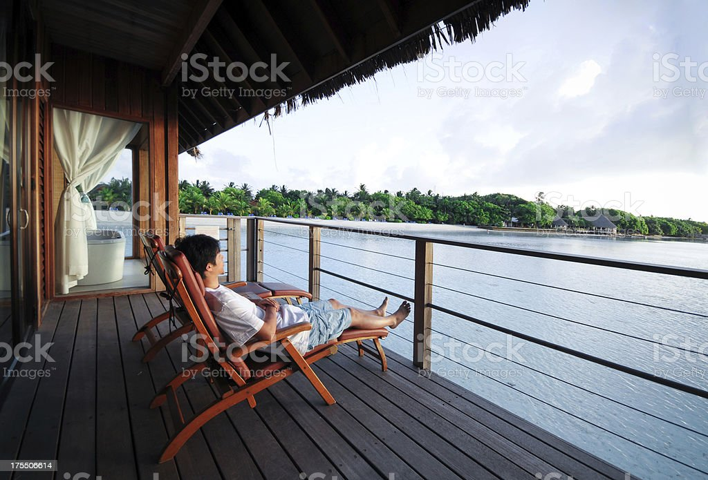 Relaxing On Deck Chair of Beach House - XLarge stock photo