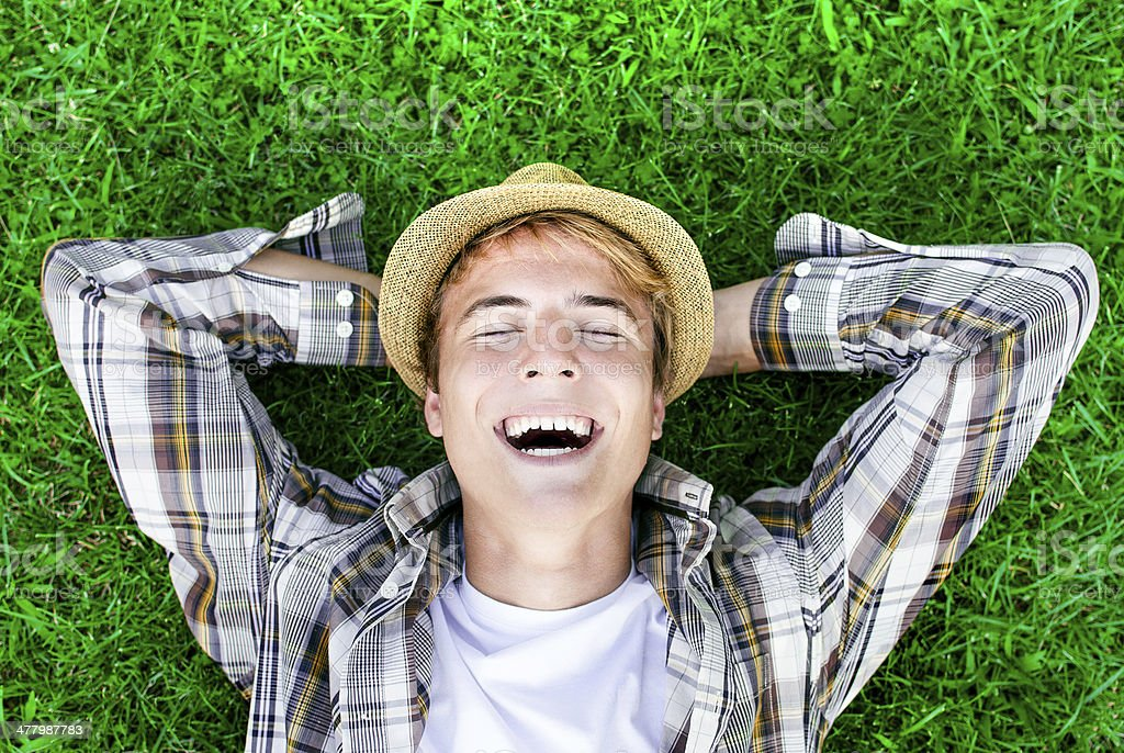 Relaxing on green grass stock photo