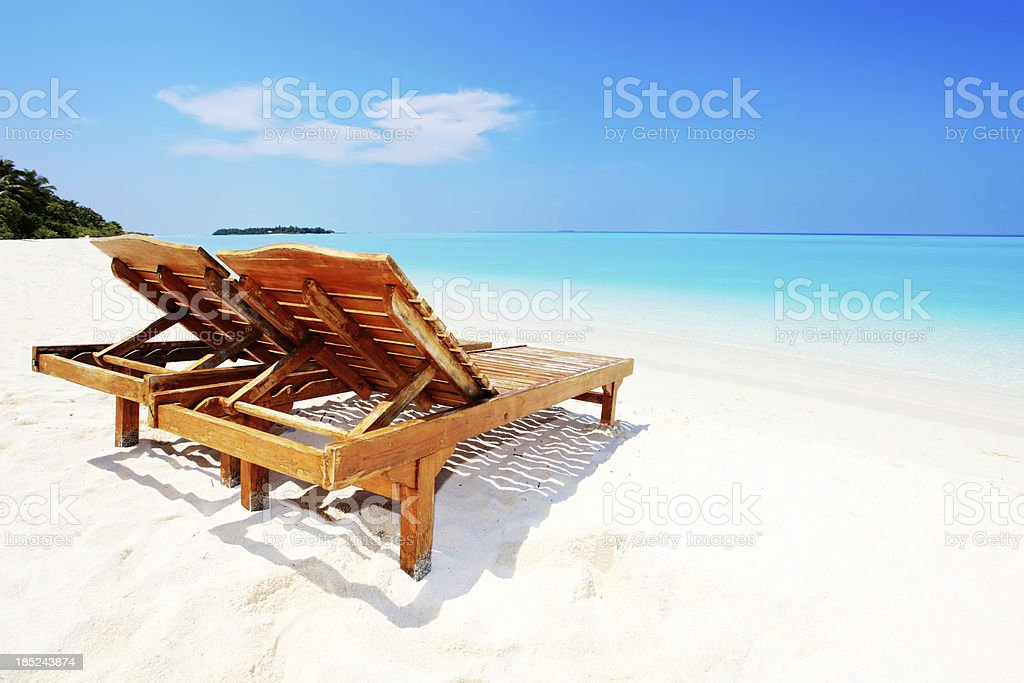 Relaxing on remote beach. stock photo